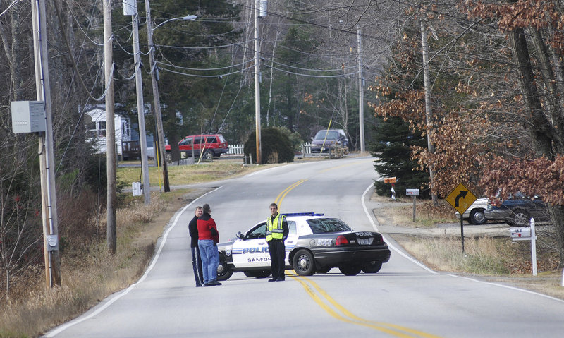 Police block off New Dam Road in Sanford during the search for fugitive David Hobson on Monday. They also questioned relatives of Hobson who live on New Dam Road.