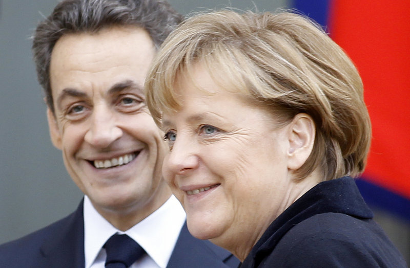 French President Nicolas Sarkozy and German Chancellor Angela Merkel announced an agreement Monday to seek mandatory limits on budget deficits among European nations.