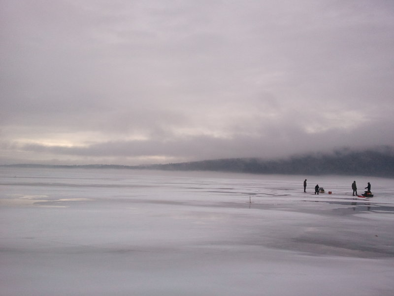 Fog rises from the surface of Great Pond in the Belgrade Lakes chain on an early January morning, prime time for two Maine men making a documentary about ice fishing.