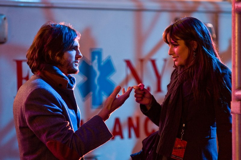 "Ashton Kutcher as Randy and Lea Michele as Elise in New Line Cinema's romantic comedy ""New Year's Eve."""