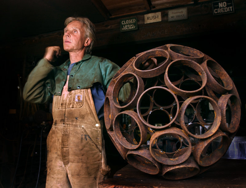 "In this 2004 file photo, Dave McLaughlin is shown with a spherical work like the one that Jay Sawyer incorporated into his piece ""Late Collaboration."""