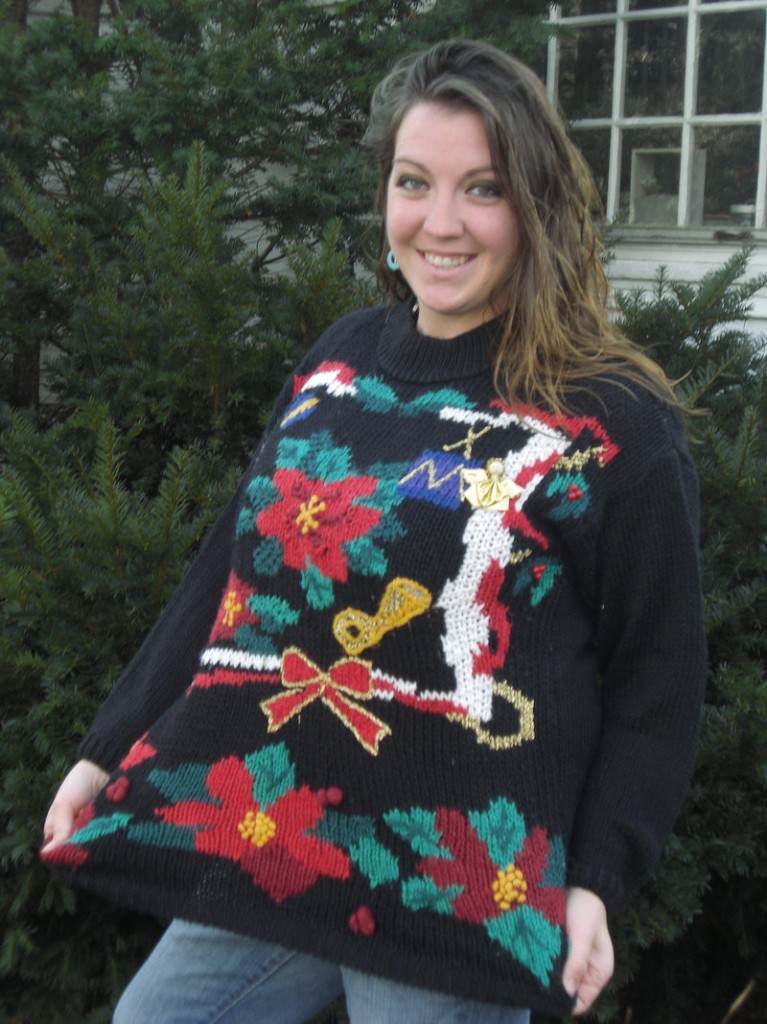 "Stacie Biddle is taking part in an effort to set a record for ""the most ugly holiday sweaters worn in one place at one time."" Admission to Sunday's event in Wells will benefit Goodwill."