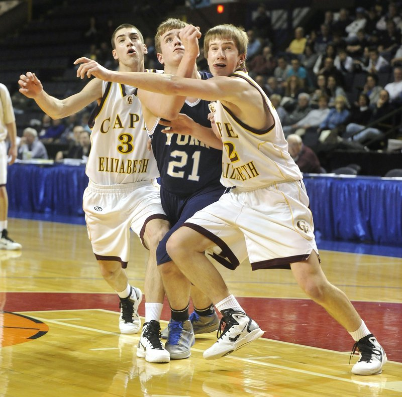 Aaron Todd, center, of York and Henry Babcock, right, of Cape Elizabeth, could have more battles this season. York may be one of the teams to beat in Western Class B and the Capers always are a tough opponent.