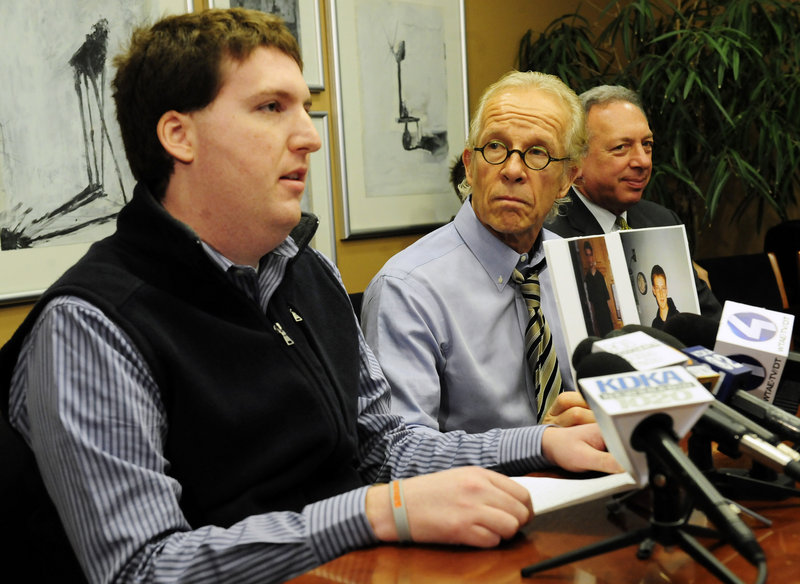Zachary Tomaselli, left, reads a statement Thursday in Pittsburgh, Pa., where his attorneys, Jeffrey Anderson, center, and Alan Perer announced a lawsuit claiming that Tomaselli was sexually abused by former Syracuse assistant basketball coach Bernie Fine in Pittsburgh in 2002.