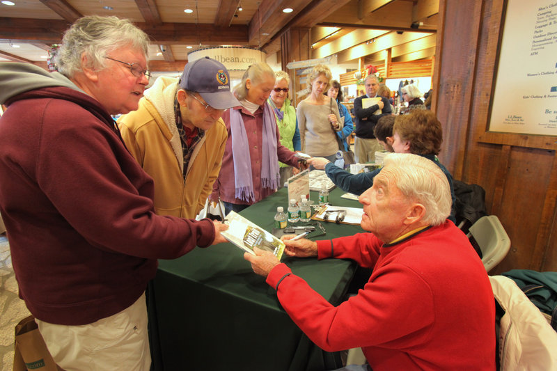 "During the book festival in Freeport on Saturday, Linda and Percy Smith, left, of Gray talk with Donn Fendler, co-author of ""Lost Trail: Nine Days Alone in the Wilderness,"" after he signed a copy of the graphic novel based on his boyhood experiences. Percy Smith said that in his youth he hiked the same trail on Mount Katahdin where Fendler got lost at age 12 in 1939."
