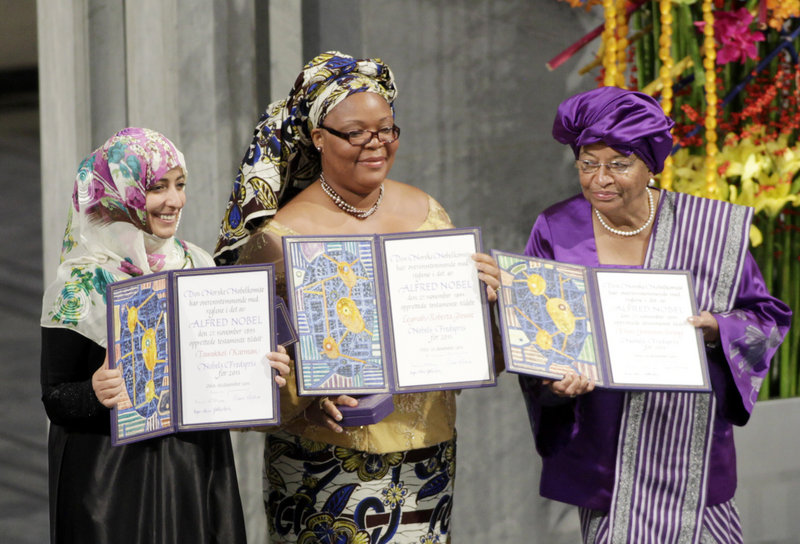 Nobel Peace Prize winners, from left, Tawakkol Karman of Yemen, Leymah Gbowee of Liberia and Liberian President Ellen Johnson Sirleaf display their awards in Oslo Saturday.