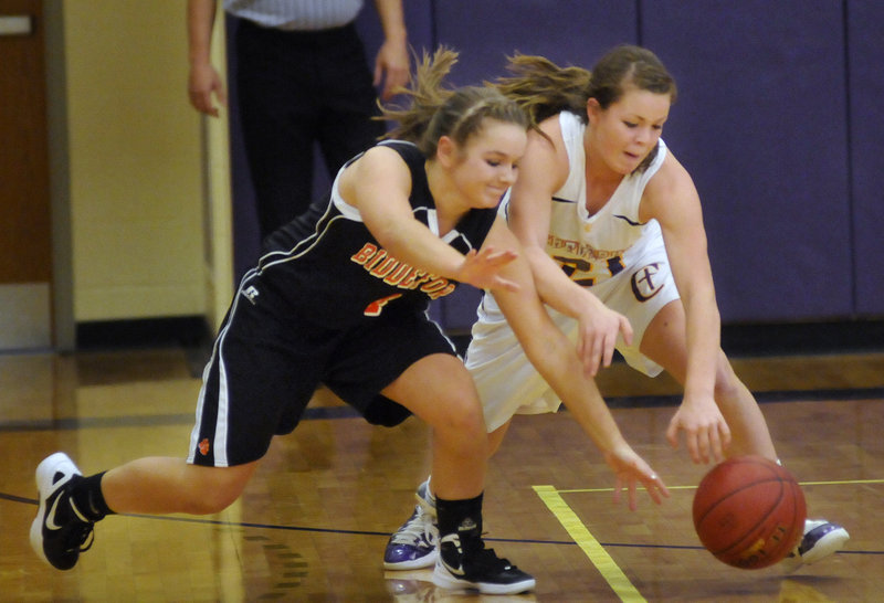 Carissa Gelinas, left, of Biddeford and Abby Maker of Cheverus head for a loose ball during their Western Class A game in Portland. Cheverus won, 68-28.