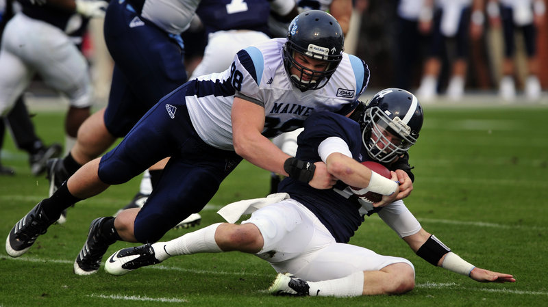 Georgia Southern quarterback Jaybo Shaw is brought down by Maine defensive lineman Craig Capella. Shaw rushed for two touchdowns and passed for another in a 35-23 win.