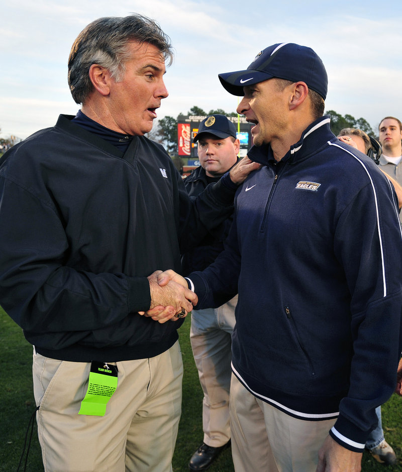 Maine Coach Jack Cosgrove, left, congratulates his counterpart, Jeff Monken of Georgia Southern, after the Black Bears fell, 35-23.