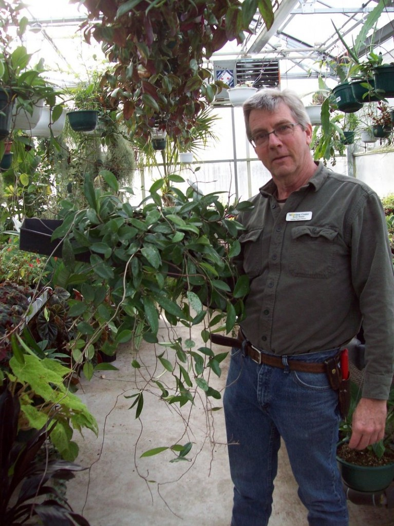 Kevin Kearns, director of the Seedling Program at the Morrison Developmental Center in Scarborough, shows a Hoya that can thrive as a houseplant in Maine.
