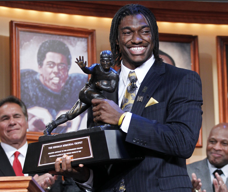 Robert Griffin III shows off the Heisman Trophy after he became the first Baylor player to win the award as the nation's top player. Griffin was chosen over Stanford quarterback Andrew Luck, who was the runner-up for the second straight year.