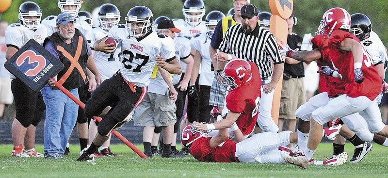 Gardiner's Alonzo Connor is forced out of bounds during a football game with Cony High School in Augusta. Guidelines in Maine schools now help athletes and other students while they recover from concussions.
