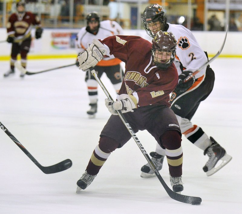 CJ Maksut, front, and Bryan Dallaire, right, were on opposite sides of the Thornton-Biddeford rivalry last year, but now they're playing together at Thornton Academy, which is seeking a second straight Class A championship.