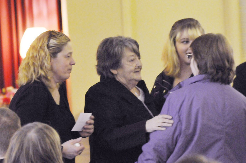 Megan Waterman's mother, Lorraine Ela, left, and grandmother, Muriel Benner, center, try to keep attention on the case.