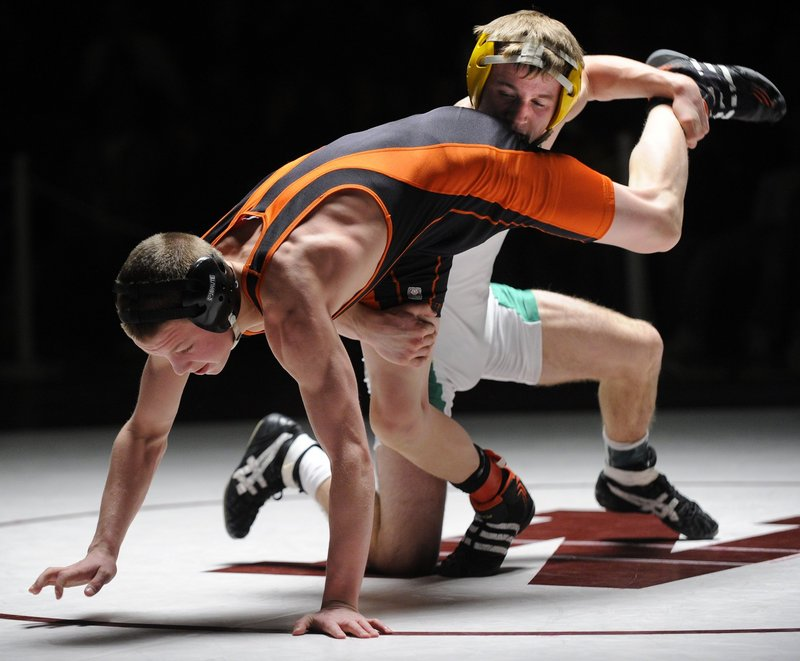 Ethan Gilman, back, of Massabesic and Jared Jensen of Brunswick each won individual state championships last year – Gilman in the 125-pound division, and Jensen at 130 pounds.
