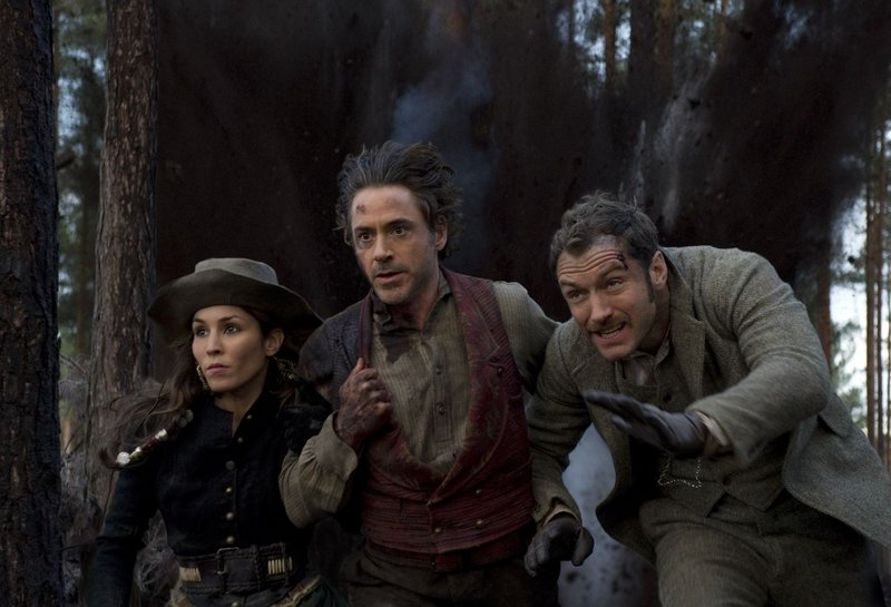 "Rapace, Downey and Law on the run in ""Sherlock Holmes: A Game of Shadows."""