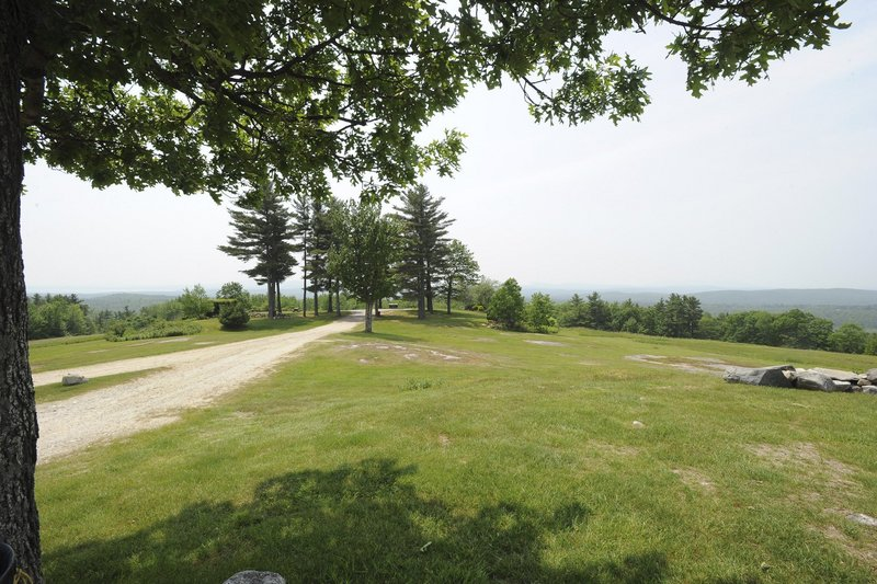 The road to the top of Hacker's Hill in Casco ends at a clearing that offers views of the Sebago Lake region, the White Mountains and the Mahoosuc Range near Bethel.