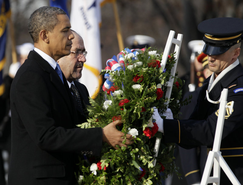 President Obama and Iraq's Prime Minister Nouri al-Maliki lay a wreath on Monday at the Tomb of the Unknowns at Arlington National Cemetery in Arlington, Va., as part of their observance of the end of U.S. intervention in Iraq.