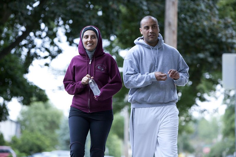 "Pediatric respiratory therapist Nawal Aoude, left, and her husband, Nader, go out for a walk in a scene from ""All-American Muslim."" A conservative Christian group's email drive prompted Lowe's to pull its ads from the series."