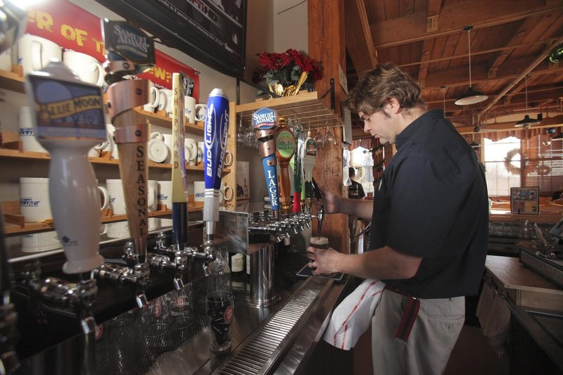 Martin Gunderson draws a Guinness at Duffy's Tavern in Kennebunk.