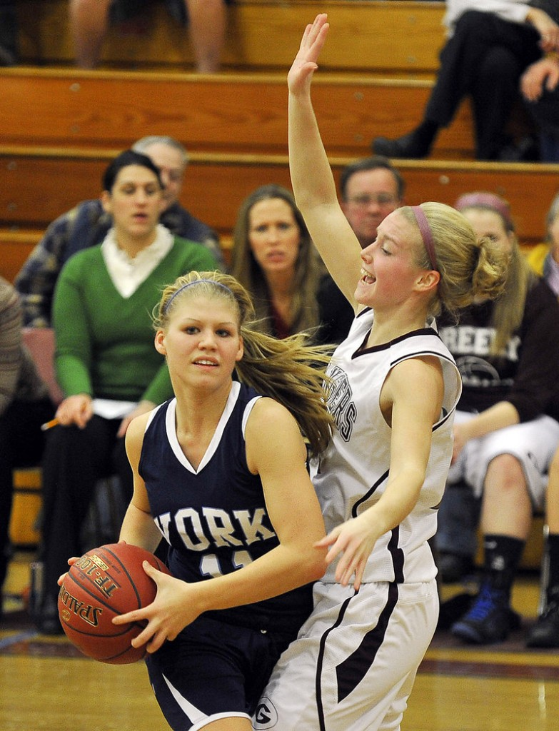 Andrea Mountford of York seeks to pass while being guarded by Greely's Caroline Hamilton Tuesday night.