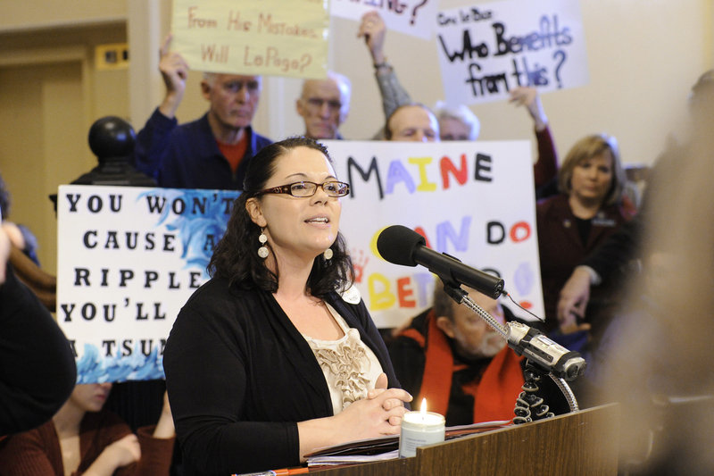 Shanna Rogers of Lewiston speaks against state health care cuts during the rally in the Hall of Flags at the State House in Augusta on Wednesday.