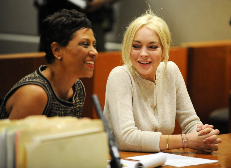 Lindsay Lohan, right, and attorney Shawn Chapman Holley are seen during a progress report session at the Los Angeles Superior Court Wednesday.