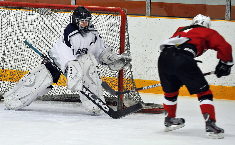 Hannah Williams of Yarmouth-Freeport stands her ground Wednesday to block a bid by Taylor Landry of Leavitt-Edward Little in the first period. Landry finished with three goals as Leavitt-Edward Little earned a 5-1 victory at Travis Roy Arena in Yarmouth.
