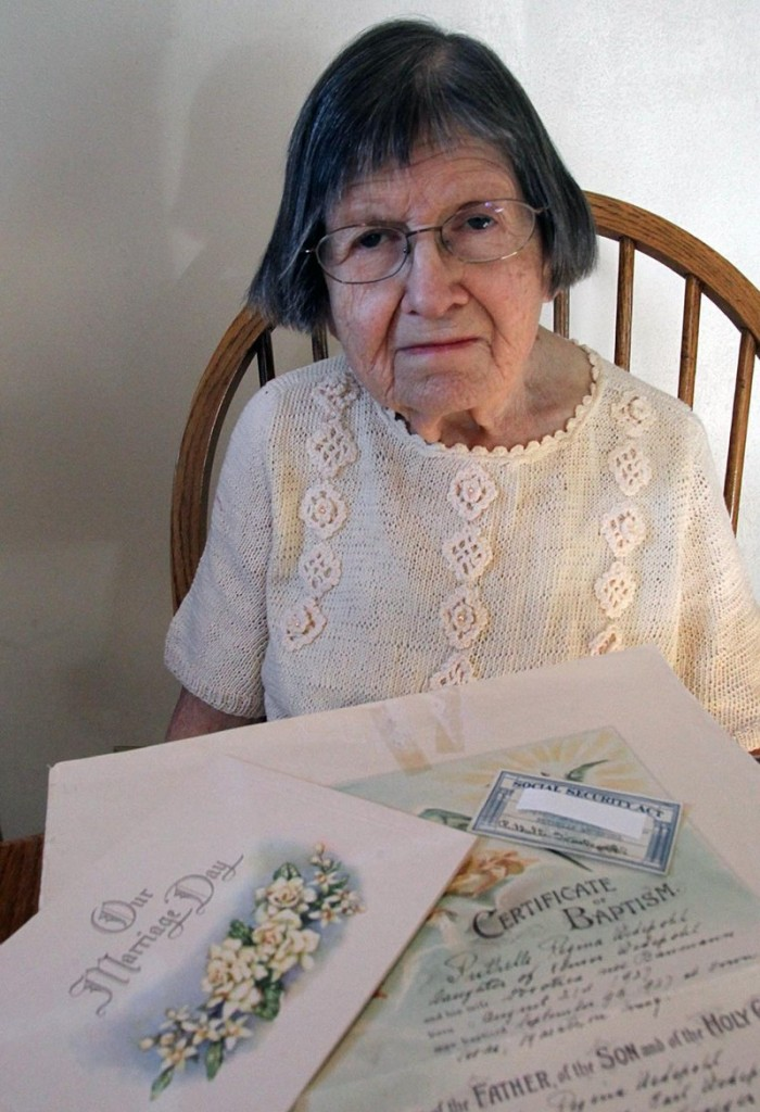 Ruthelle Frank, at home in Brokaw, Wis., shows some of the documents that were not good enough to get her a state voter ID.