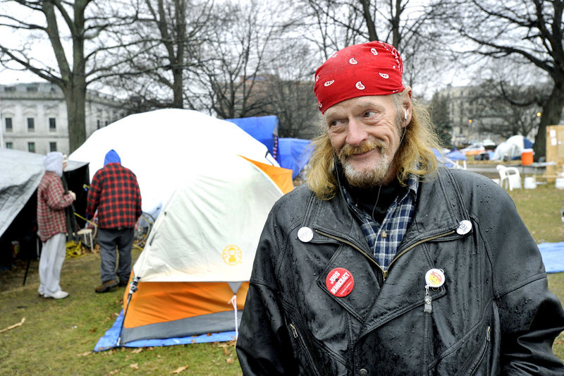 Occupy Maine member Harry Brown spends time Thursday in Lincoln Park. The group has camped there since October to call attention to corporate greed and socioeconomic injustice.