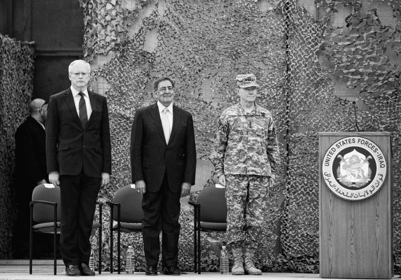 Ambassador to Iraq James Jeffrey, left, and Secretary of Defense Leon Panetta, center, stand during ceremonies in Baghdad, Iraq, on Thursday.