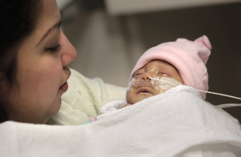 Haydee Ibarra holds her 14-week-old daughter, Melinda, on Wednesday at a Los Angeles hospital. Melinda is believed to be the second-smallest baby to survive in the U.S.