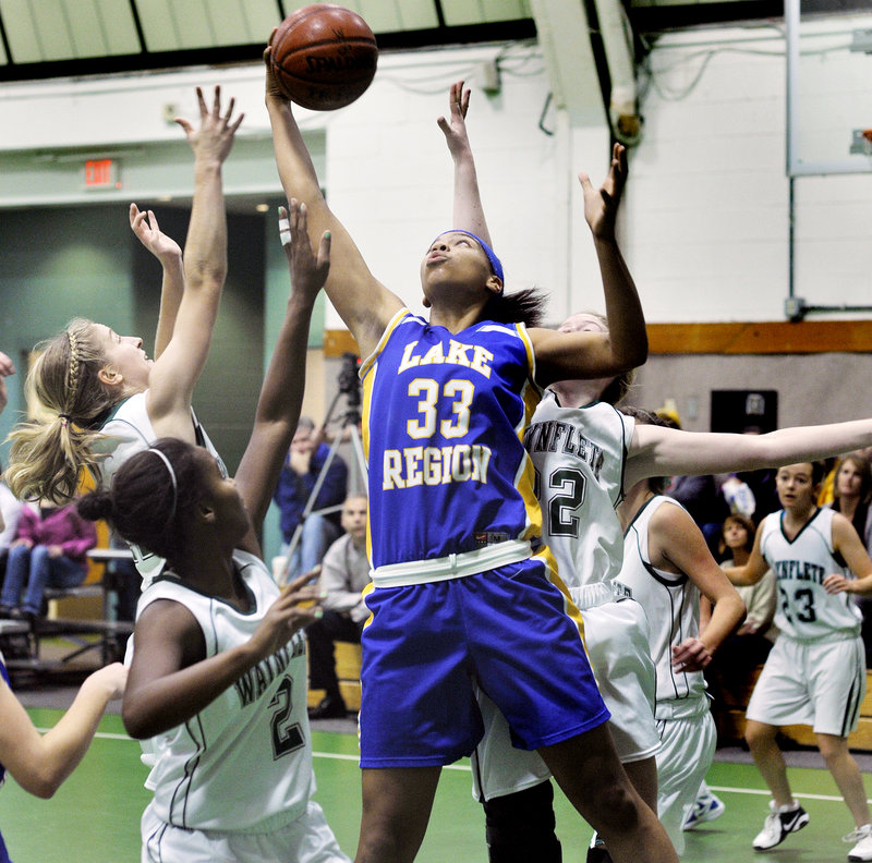 Tiana-Jo Carter, the 6-foot-1 center for Lake Region, hauls down an offensive rebound Thursday during the 45-36 victory against Waynflete. Carter finished with 13 points to help the Lakers improve to 3-0.