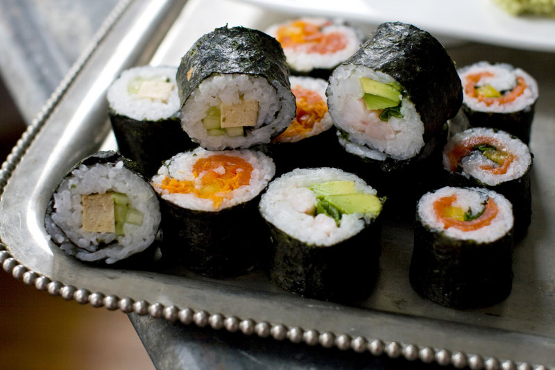The maki roll, the sushi variety Americans are most familiar with, features sheets of nori seaweed wrapped around cooked sushi rice and a variety of fillings. These are easy to prepare and easy to personalize.