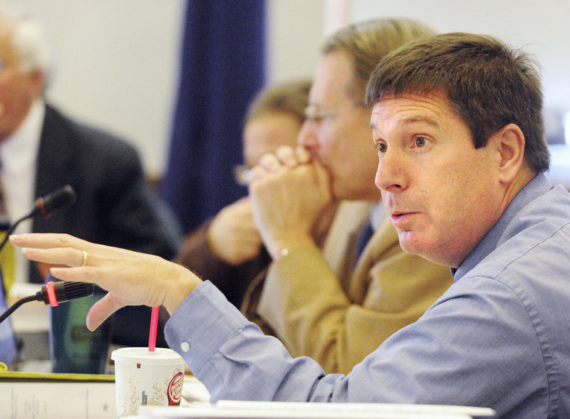 Rep. Ken Fredette, R-Newport, asks a question Friday, the third day of a public hearing on Gov. Paul LePage's proposed cuts to the Department of Health and Human Services' budget, at which 360 people signed up to testify.