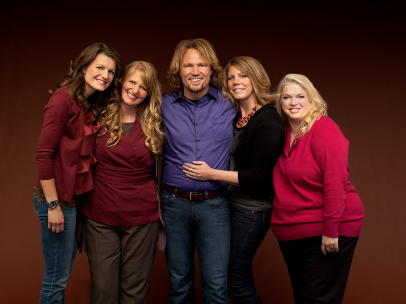 "Kody Brown, center, and his wives, from left, Robyn, Christine, Meri and Janelle, are the focus of the TLC reality series, ""Sister Wives."" The famous polygamists are challenging Utah's bigamy law in court."