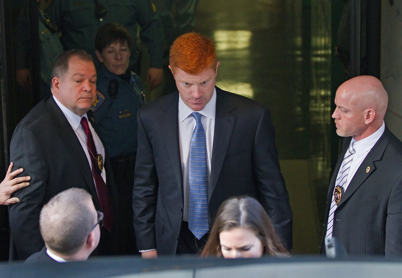Mike McQueary, center, Penn State assistant coach, testified Friday that he walked in on Jerry Sandusky engaging in what McQueary believes was the sexual assault of a boy in 2002.