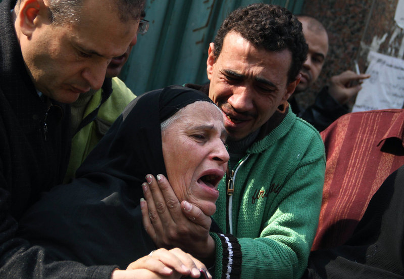 Relatives of Egyptian protesters who were killed during the latest clashes with soldiers mourn in Cairo on Saturday. At least nine people were killed and more than 300 were injured in fighting after the military tried to crush protests in Tahrir Square Friday and Saturday.