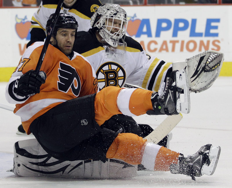 Maxime Talbot of the Flyers crashes into Bruins goalie Tim Thomas during Saturday's game in Philadelphia. Thomas made 31 saves in a 6-0 victory.