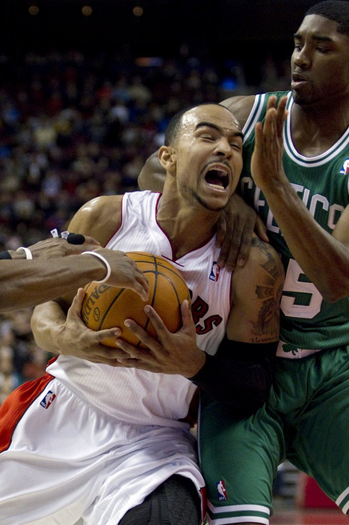 Jeryd Bayless of the Raptors drives to the basket while being defended by Boston's E'Twaun Moore in the first half of Sunday's NBA exhibition game at Toronto. The Celtics won, 76-75.