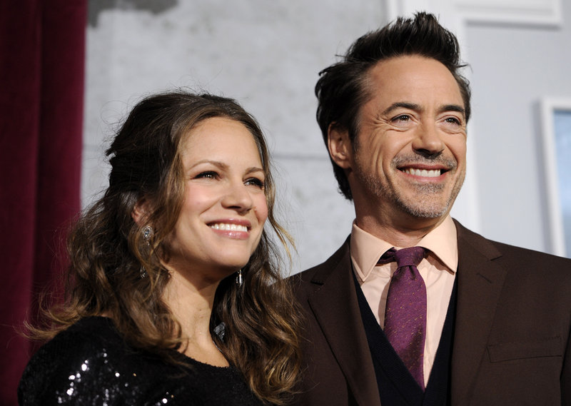 """Robert Downey Jr., star of """"Sherlock Holmes: A Game of Shadows,"""" attends the premiere Dec. 6 with his wife, Susan, a producer of the film."""