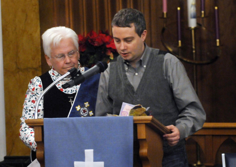 """Matt Winters of Scarborough gives a reading with Weaver's support. """"Even churches who say all are welcome have some difficulty including people with disabilities,"""" Weaver says."""