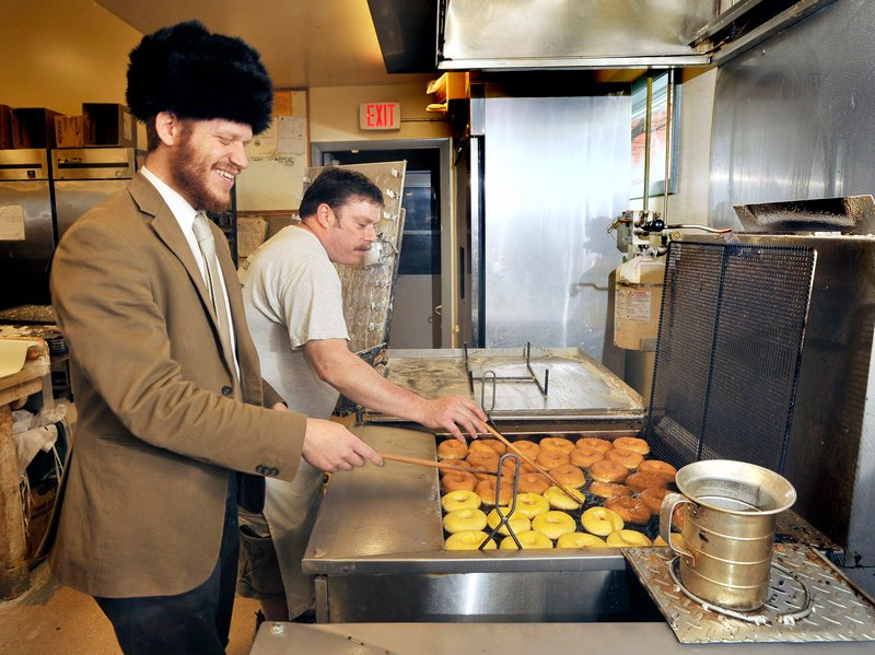 Portland Rabbi Akiva Herzfeld and Tony's Donuts baker Tim Hunnewell prepare a batch of doughnuts.