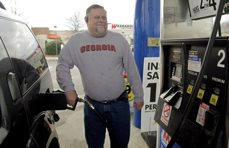 "Michael Reed fills his gas tank last week in Charlotte, N.C. Out of work since 2009, he feels the pain of high gas prices more than many others. ""I try to drive as little as possible so it doesn't take such a chunk out of my wallet,"" he said."
