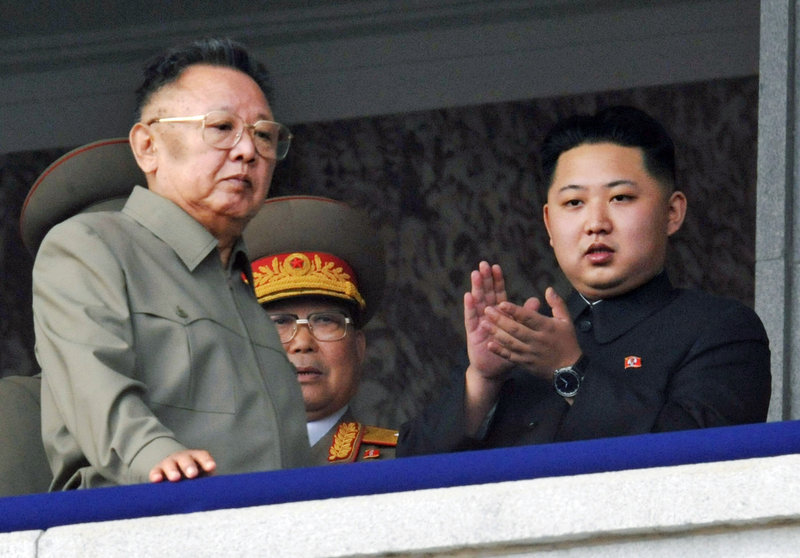 Kim Jong Un, right, and his now-deceased father, Kim Jong Il, attend a military parade last year. North Koreans are unfamiliar with Kim Jong Un, whose name was mentioned in public only 15 months ago and whose father never explicitly endorsed him as his successor.