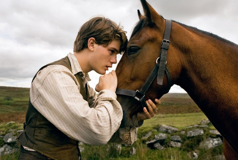 "Albert, played by Jeremy Irvine, with his beloved Joey in ""War Horse."""