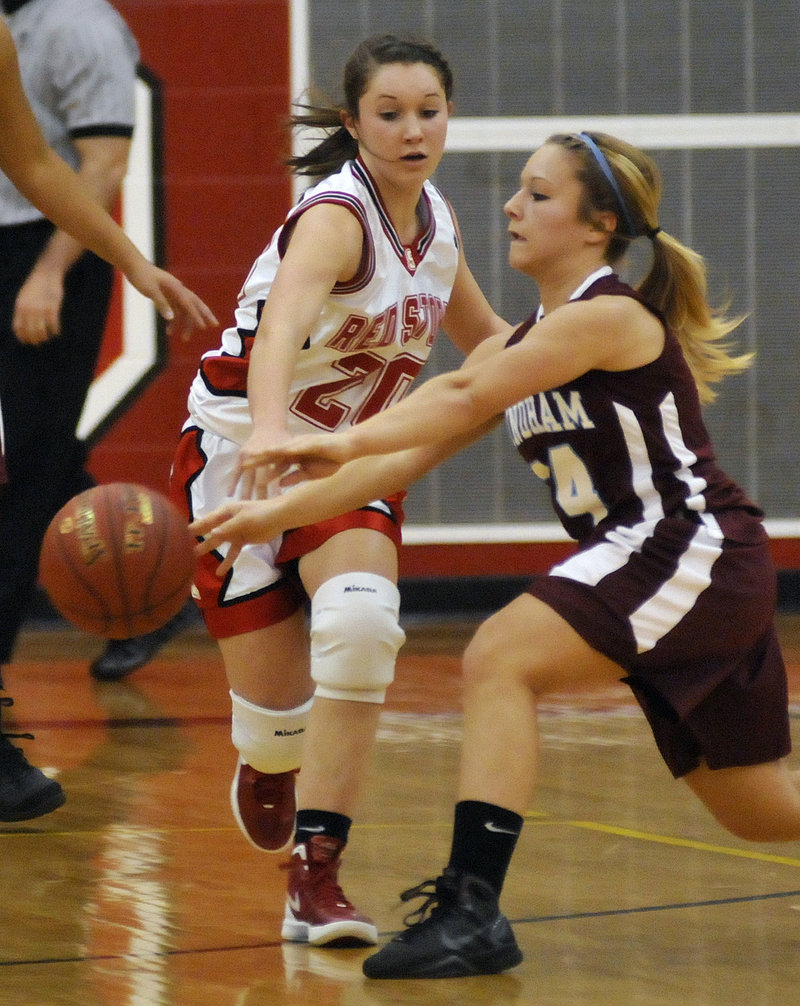 Ashley Briggs of Scarborough reaches for the ball Tuesday night as Bebe Butts of Windham, right, makes a pass during Scarborough's 46-44 victory.