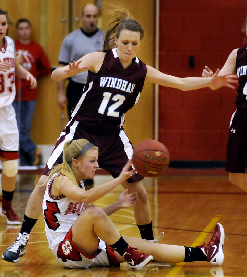 Maria Philbrick of Scarborough looks for an open teammate Tuesday night after grabbing a loose ball. Sam Frost defends for Windham. Scarborough came away with a 46-44 victory at home.