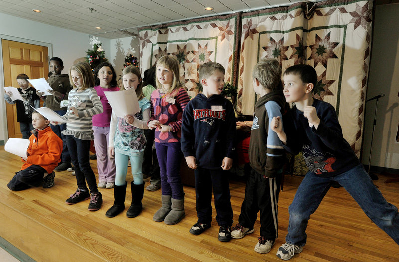 Hall Elementary School students sing holiday songs at the Barron Center.