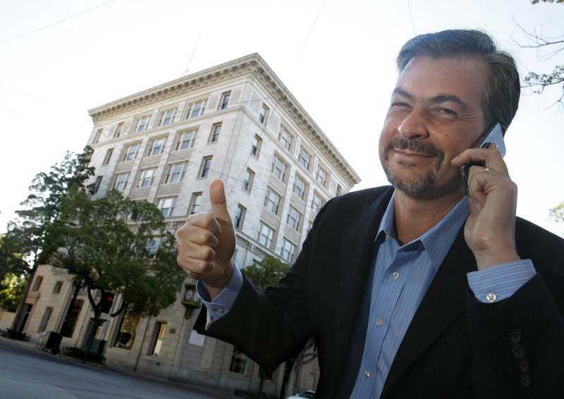Andy Shibley, a general manager for AT&T, confirms a strong signal from an AT&T cell site hidden inside the historic 1920s office building behind him that Richard M. Nixon once used as a law office in Whittier, Calif.